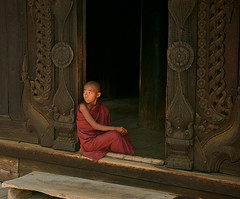 Thoughts of a Novice (Aubrey Stoll) Tags: shwenandaw monastery mandalay buddhism buddha religion burma myanmar robe red wood patterns carving architecture south east asia tropic novice student monk thoughts holy ground