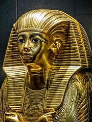 Inner miniature gilded coffin depicting King Tutankhamun in royal headdress from nested set of coffins containing keepsakes New Kingdom 18th Dynasty Egypt 1332-1323 BCE (mharrsch) Tags: gold pharaoh king ruler coffin tutankhamun burial tomb funerary 18thdynasty newkingdom egypt 14thcenturybce ancient discoveryofkingtut exhibit new york mharrsch premier exhibits miniature gilded