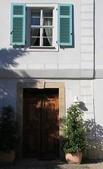 1997. Door to Friedrich Rückert museum. (Gerlinde Hofmann) Tags: door shadow building window museum germany bavaria town coburg year franconia shutter 1997 flowerpot initial rückert neuses