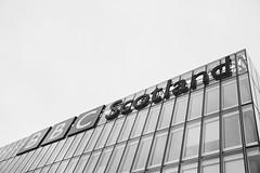 BBC Building, Glasgow (lorenzoviolone) Tags: uk trip travel windows sky blackandwhite bw building glass monochrome architecture radio scotland blackwhite reflex nikon fav50 glasgow grain ilfordhp5 bbc dslr radio1 appleaperture fav1