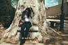 sitting on stone bench with tree growing around it (gorbot.) Tags: palermo roberta lightroom villagiulia rangefindercamera mmount veryoldtrees leicam8 voigtlander28mmultronf19 vscofilm