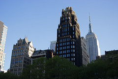 Bryant Park Hotel (Bob Bain1) Tags: new york nyc trees sky usa sun gardens skyline america skyscraper buildings manhattan famous empirestate iconic bryantpark