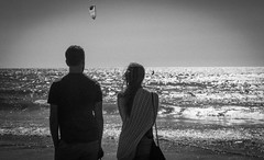 Seekers (magnetic_red) Tags: ocean blackandwhite sunlight beach water oregoncoast youngcouple searching