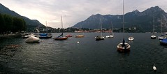 Evening in Lecco (David J. Greer) Tags: sea cloud mountain lake mountains water clouds sailboat dark evening still cloudy calm anchor mooring mast sailboats moor masts buoy anchored moored