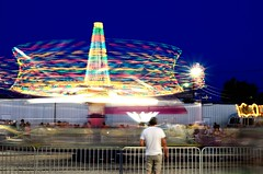 Whirling Lights (mitchell_vanerdewyk) Tags: longexposure carnival blue light red lightpainting color green yellow dark painting downs lyon crowd trails fair ups rides lighttrails countyfair peoplewatching fairrides lyoncounty