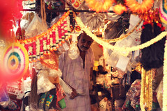 The old man at the store (archonline) Tags: street old man colors store colorful bangalore business gandhi clutter bazar