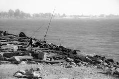 Fishing Time (Yamila Barcia) Tags: sea blackandwhite bw beach muelle mar fishing sand buenosaires rocks photographer playa arena seashore mardelplata orilla