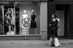 Bridal (Silver Machine) Tags: winchester hampshire streetphotography street streetportrait candid girl smoking shopping bridal window windowdisplay standing candideyecontact carrierbags sunglasses phaseeight mono monochrome blackwhite bw fujifilm fujifilmxt10 fujinonxf35mmf2rwr