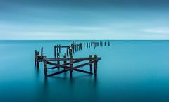 Abandoned Pier (Anthony White) Tags: swanage england unitedkingdom gb longexposure firecrest16stopnd abandoned pier blue dorset jurasiccoast seagull smooth needles decay victorianbuildingdecay