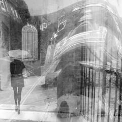 Urban Maze (Lemon~art) Tags: woman umbrella windows fence street manipulation warp layers photomontage bw blackandwhite monotone building urban