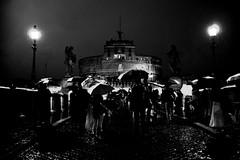 rain over the castle (giotn) Tags: street bw roma rain umbrellas castelsantangelo