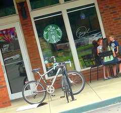 Two Bikes, 4 People, Reflections (danagraves) Tags: angles insideoutside windowreflections normanok parkedbicycles starbuckscoffeeshop brookhavenmall interestingchildrensfaces twointriguingadultswhoapparentlyhavenoconnection paintedpapersigns