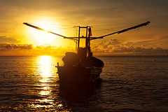 Thai fishing boat (Patrick Foto ;)) Tags: ocean travel light sunset sea sky people sun fish male net beach nature wet asian coast boat seaside twilight fishing fisherman workers asia fishermen traditional wave atmosphere fishnet jakarta shore catch tradition seashore