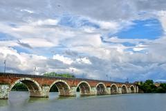 Pont Napolon, Moissac (Curufinwe - David B.) Tags: bridge sky cloud france rain clouds river arch minolta cloudy sony riviere bricks pluie arches rivire rainy pont riverbank nuage nuages tarn hdr highdynamicrange tarnetgaronne moissac midipyrnes a700 2485 pontnapolon sonyalpha700