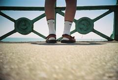 summer's here! (fotobes) Tags: sea sky feet socks lca brighton legs pavement sandals bluesky minimal analogue railings whitesocks kodak400cn socksandsandals brightonseafront ratseyeview