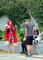 Just another day on the sea wall (Ruth and Dave) Tags: red woman anime men girl vancouver hair costume communitycentre dressup seawall fantasy cloak olympicvillage