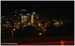 City Under Construction (jhumbrachtphotography) Tags: light ford night highway michigan trails grand rapids gerald r