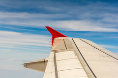 Wing (Skagos26) Tags: travel sky clouds airplane flying aircraft flight jet engine transportation rudder wingtip airasia
