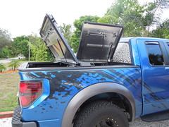 Black Aluminum Bed Cover on Ford Raptor (DiamondBack Truck Covers) Tags: ford aluminum c pickuptruck f150 raptor cleat diamondback bluetruck diamondplate ff09 tonneaucover truckbedcover passengersideview twopanelsopen blacklinex ruggedblack addedcleats