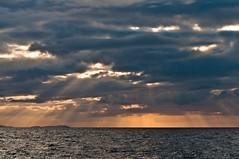 West (13 Monkeys) Tags: sea sky water scotland boat northwest rays rib cluds gairloch