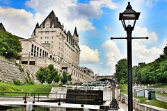 Ottawa Ontario ~ Canada ~  Rideau Canal Locks ~ Locks 1-8 ~Looking Up ~ Historical (Onasill ~ Bill Badzo) Tags: travel bridge light sky cloud ontario canada macro building heritage up museum architecture canon buildings lens rebel hotel canal site looking lodging ottawa sigma parliament landmark visit historic national boating historical locks d100 18 chateau 1001nights fixture laurier oldest rideau attraction eso sl1 vessels on bytown 1001nightsmagiccity onasill 15250mm