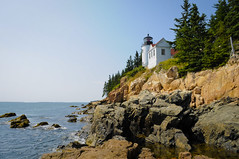 Bass Harbor Head Light (Narratography by APJ) Tags: blue light sky lighthouse island travels rocks day maine newengland cliffs clear mountdesert apj basshead narratography