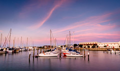 Aiming for Veritas (ajecaldwell11) Tags: sunset ankh water port buildings boats light masts tide newzealand sea napier hawkesbay yachts dusk sky mooring warehouses caldwell ahuriri clouds