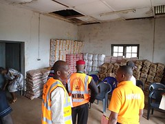 The NEMA South East new Zonal Coordinator, James Eze Major and staff of the zone, inspecting the relief materials given to Ebonyi State by the Agency