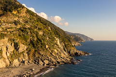 Rugged Italian Riviera (NykO18) Tags: ocean sunset sea italy plants water forest landscape dawn coast woods flora europe liguria hills shore cinqueterre vernazza mounds liguriansea mediterraneansea laspezia parconazionaledellecinqueterre naturalelement