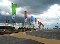 Enjoy it, Share it, Discover it (DncnH) Tags: sky cloud london rain sport athletics running flags olympicpark jogger stratford queenelizabetholympicpark
