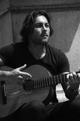Flamenco (M' aral) Tags: street light shadow blackandwhite man spain guitar guitarra granada singer canto flamenco cantaor