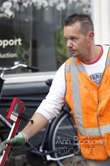 man drawing the line (abackaert) Tags: man amsterdam canals metering bloemgracht streetwork wegwerkzaamheden