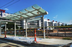 New MetroRail station at the Convention District (elnina999) Tags: park plaza new city travel blue trees windows sky urban panorama cloud reflection building cars window glass lamp skyline architecture modern skyscraper fence buildings circle corporate drive office high highway downtown day commerce cityscape texas exterior view traffic cloudy district famous platform houston sunny landmark center panoramic business round infrastructure metropolis tall shape finance nikond5100