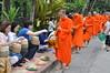 The faithful giving to the monks (shankar s.) Tags: southeastasia earlymorning buddhism tourists lp laos luangprabang buddhistmonk laopdr makingmerit unescoworldheritagecity buddhistreligion takbat buddhistfaith morningalmsgivingritualluangprabang morningalmsgivinginluangprabang