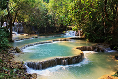 Tat Kuang Si (pietkagab (on the road)) Tags: park trip travel blue trees wild green nature water canon landscape photography bush asia bright south falls east backpacking waterfalls laos luangprabang kuangsi tatkuangsi 450d pietkagab therubyawardsinvitation
