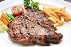 t-bone steak (Andre Maryland) Tags: red food industry menu indonesia french restaurant beef main tbone plate bbq vegetable grill course potato fries strip steak barbecue oil oily bone grilled fried loin porterhouse tenderloin striploin
