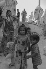 The two sisters.. (spartanparth) Tags: life street city people bw streets cute kids sisters children kid innocent siblings human innocence cuteness humans slums