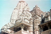 23-110 (ndpa / s. lundeen, archivist) Tags: india color detail building film architecture 35mm temple indian stonework details nick temples 23 1970s hindu figures jain sculptures khajuraho dewolf madhyapradesh nickdewolf photographbynickdewolf reel23 kandariyamahadeva kandariyamahadevatemple khajurahogroupofmonuments