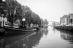 Dordrecht Wolwevershaven (Tijmon Kater) Tags: blackandwhite bw mist haven holland reflection water boats boot mirror harbor nikon zwartwit 1870mmf3545g dordrecht nikkor biesbosch zuidholland reflectie onzelievevrouwekerk nieuwehaven nederlandvandaag d7000 tijmonkater