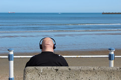 IMG_9368_small_F (Paul Russell99) Tags: weymouth headphones sea beach waves seaside head bald shaven