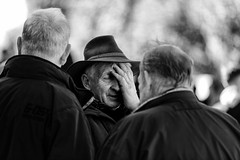 Pained expression (Frank Fullard) Tags: frankfullard fullard street conversation portrait people hat pain painful expression drama monochrome blackwhite lol fun irish ireland ballinasloe fair galway