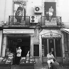 Lisbon street scene (tim rob .) Tags: shopkeeper portugal shops street lisbon