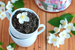 Green tea leaves  with jasmine (oleksandra.usenko) Tags: morning summer stilllife brown white flower tree cup yellow table lunch leaf cozy raw tea drink jasmine chinese cook dry delicious smell stamen taste pollen exquisite greentea pleasant selectivefocus greentealeaves