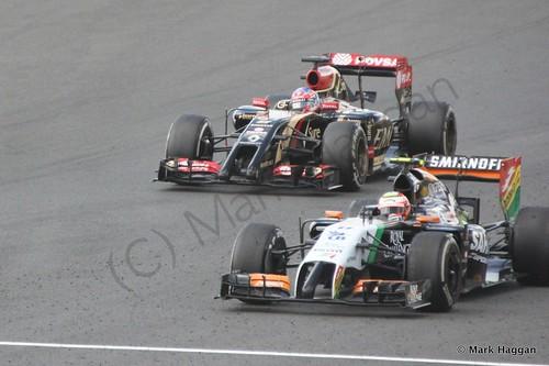 Romain Grosjean and Nico Hulkenberg during The 2014 British Grand Prix