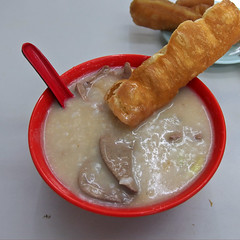 Nam Loong Porridge ( Slices of Light   ) Tags: china food hongkong restaurant pig chinese olympus hong kong donut   kidney kowloon mongkok liver congee porridge  nam yao  youtiao tiew loong      xz2