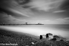 (Claire Hutton) Tags: wood uk longexposure sea summer england sky blackandwhite bw white holiday seascape beach water monochrome clouds lens prime mono coast pier daylight wooden worthing seaside rocks westsussex britain outdoor jetty smooth wideangle pebbles le gb daytime stony milky groyne ndfilter 10stop nd110 10stopper sonynex5r samyang12mmf20