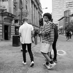 P9033741-1-2 (Lawrence Holmes.) Tags: streetphotography street mono blackandwhite eyecontact clocked manchester uk olympusc7070