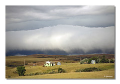 Montana Cold Front (rjmonner) Tags: ranch travel blue vacation sky house storm abandoned nature weather clouds squall rural fence landscape rising montana mood farm hill farming rustic neglected grain dramatic vivid bin land bigsky homestead agriculture pastoral striking powerful deserted thunder threat menace agricultural meteorology gust precipitation intimidation climatic agronomic