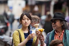 Dirty Ice Cream (Monsieur Etienne) Tags: street portrait woman paris ice girl hat sunglasses canon asian glasses dof bokeh candid cream dirty icecream f2 135mm 5dmarkii