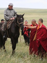 Buddhist Monks Steppe Grasslands Tuva Central Asia Russia (eriagn) Tags: monk buddhist red robe buddhism horse тува́ asia heartofasia russia southernsiberia tuvarepublic tyva kyzyl mongolia altai remote men women horses nationalsport longdistance horseracing leather boots public display fitness skilled flags robes steppe rolling grasslands eriagn ngairelawson ngairehart documentary social travelphotography history historyandmystery wrestlingtournament blue competitive competition khuresh athlete agility determination costume leatherboots siberia action skill athleticism